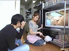 Japanese hottie watches porn and gets amazingly fucked