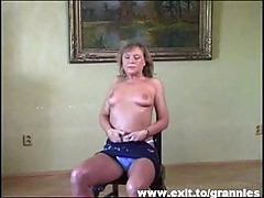 54 years Grannie Tina toys herself to an orgasm