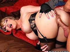 Maya Hills in a corset taunts her man with her big natural tits