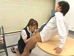 Japanese hottie Riona Minami sucks her boss's cock in the office