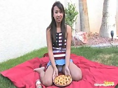 Horny Asian teen has breakfast outdoor