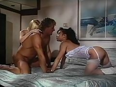 Alicyn Sterling and Mimi Miyagi share Randy West's hard dick