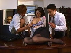 Cute Japanese woman is having group sex in office