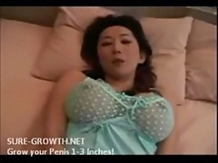 Stunningly gorgeous Asian with huge tits nails her pussy with a raging cock