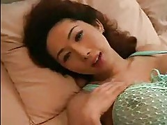 Sexy Asian brunette with big tits fucks on soft couch